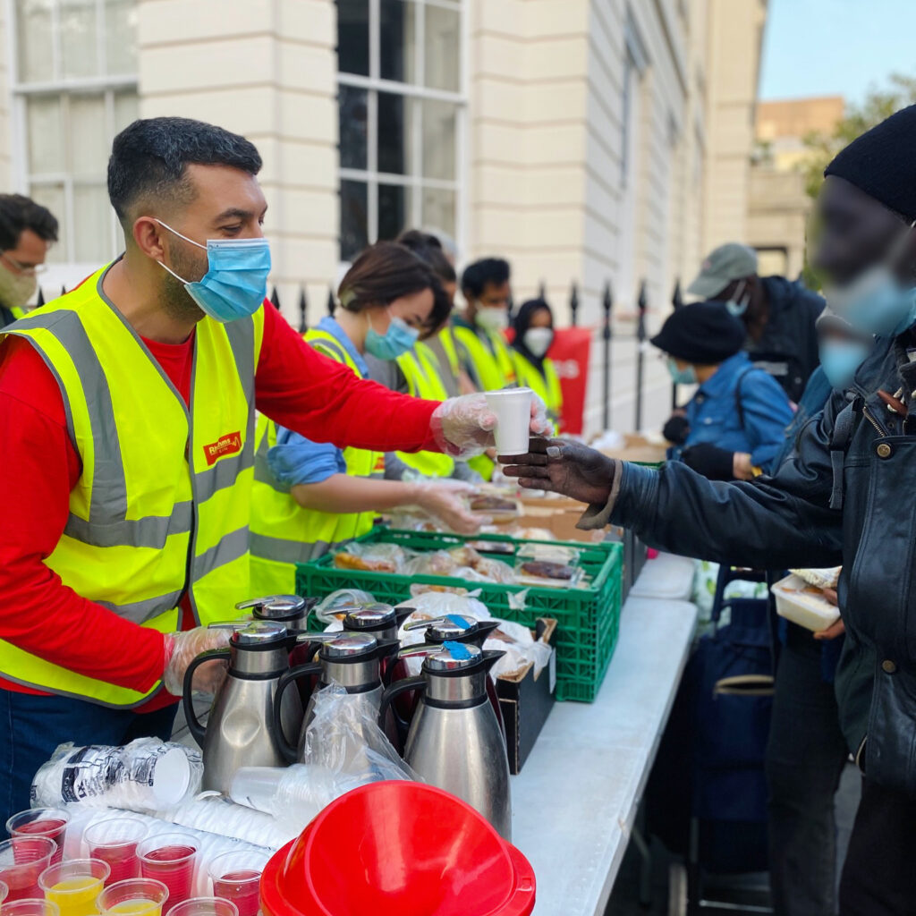 volunteers serving coffee to homeless- Rhythms of life charity in London
